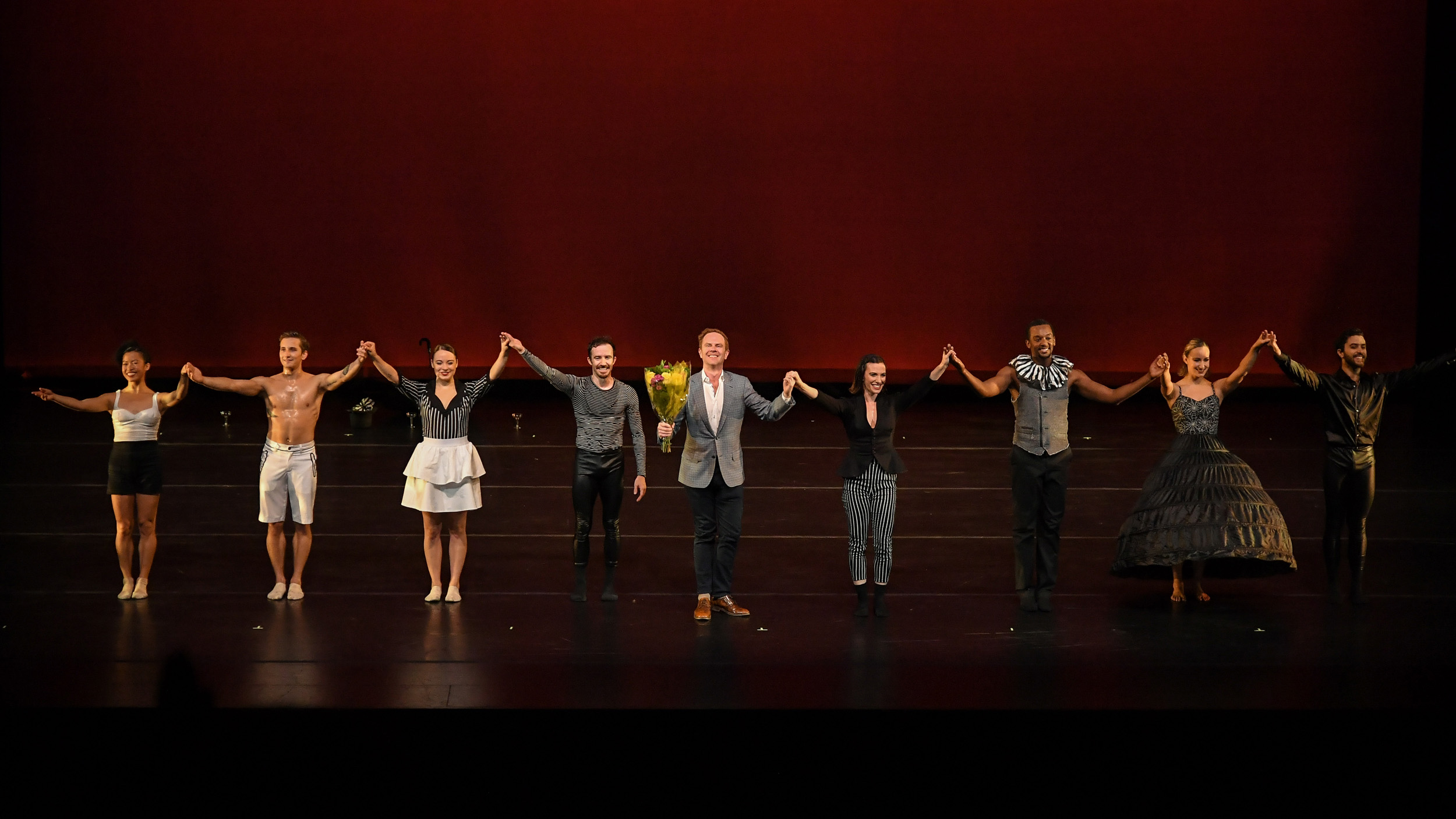 BODYTRAFFIC performing at the Wallis Annenberg Center for the Performing Arts May 31, 2018. A Million Voices (World Premiere). Choreography: Matthew Neenan. (l-r) Jessica Liu, Lorrin Brubaker, Haley Heckethorn, Guzmán Rosado, choreographer Matthew Neenan, Tina Finkelman Berkett, Jamal White, Natalie Leibert, Joseph Davis. PHOTO CREDIT: Rob Latour.